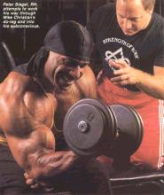 sports hypnotherapist Peter Siegel hypnotising bodybuilder Mike Christian dumbell curls