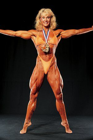 female body builder cory everson Mrs Olympia poses with award